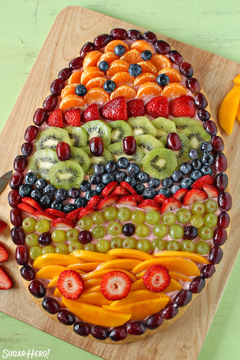 Overhead shot of Easter Egg Fruit Pizza on a wooden cutting board