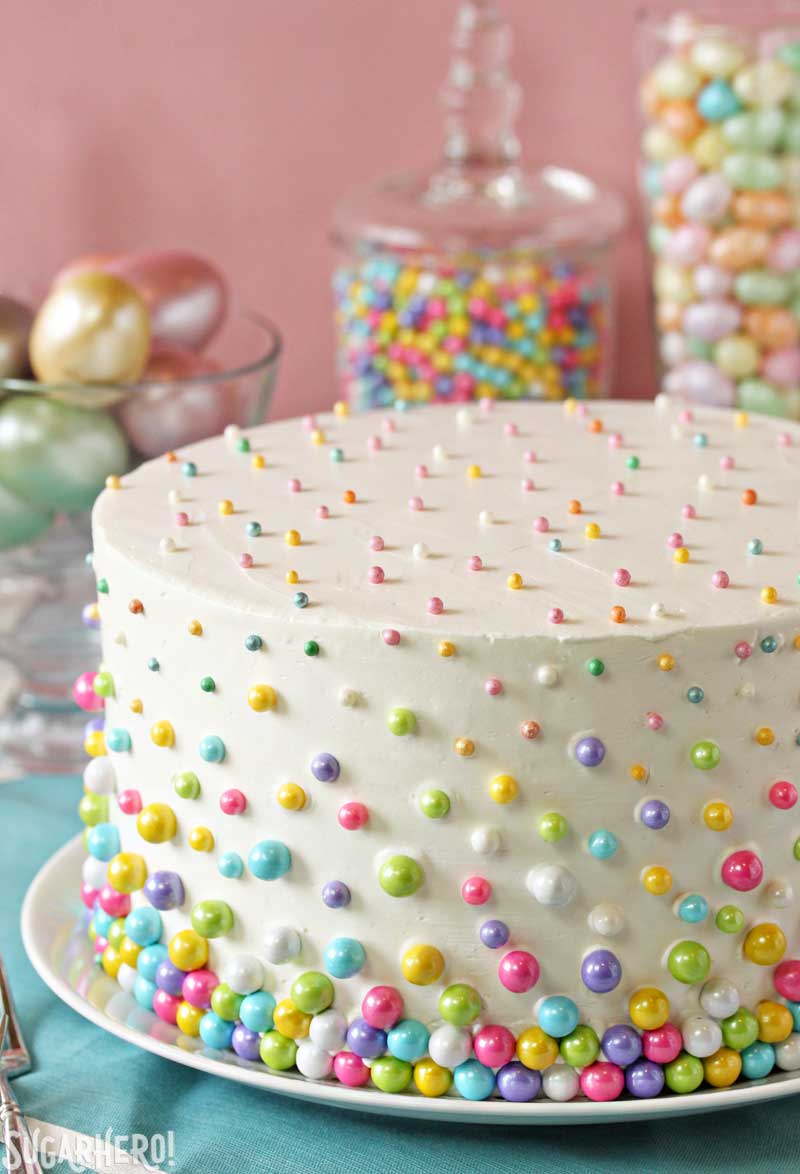 Easter Polka Dot Cake - a spring cake with polka dots on the outside AND inside of the cake! | From SugarHero.com