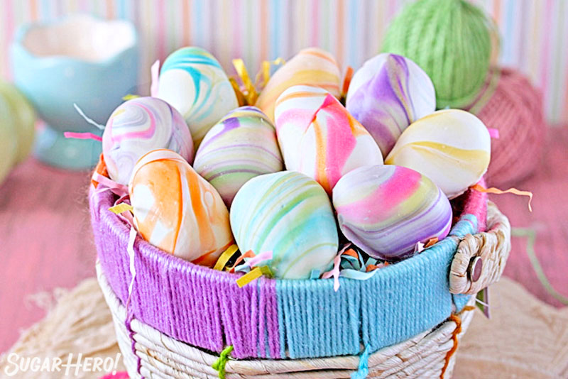 Marbled Easter Egg Truffles - A close up of the pretty pastel swirls on the truffles. | From SugarHero.com