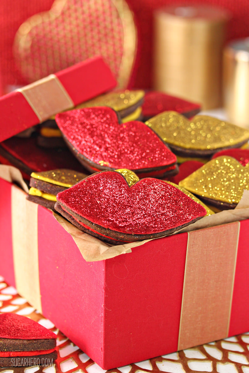 Red Hot Love Cookies - rich chocolate cookies sandwiching a spicy cinnamon buttercream, and finished with gorgeous glittery decorations! | From SugarHero,com