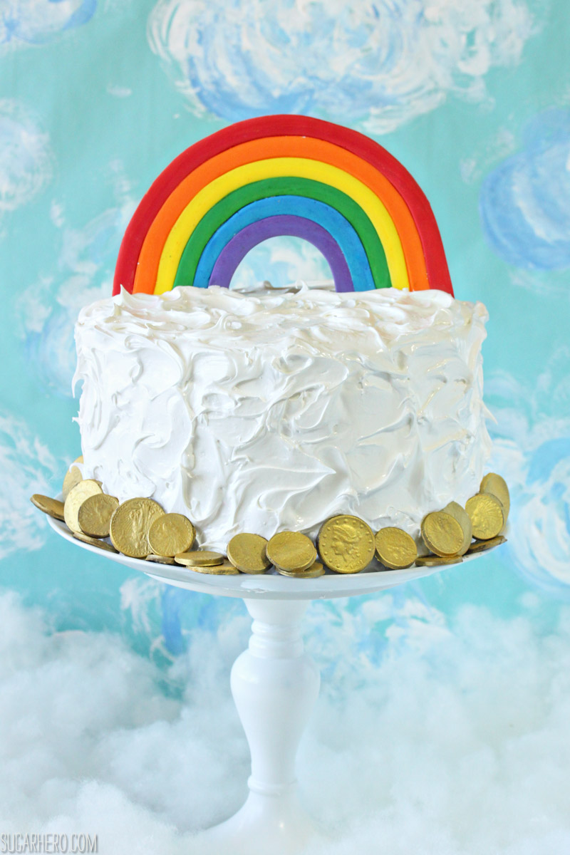 Rainbow in the Clouds Cake - with rainbow buttercream and fluffy cloud frosting | From SugarHero.com