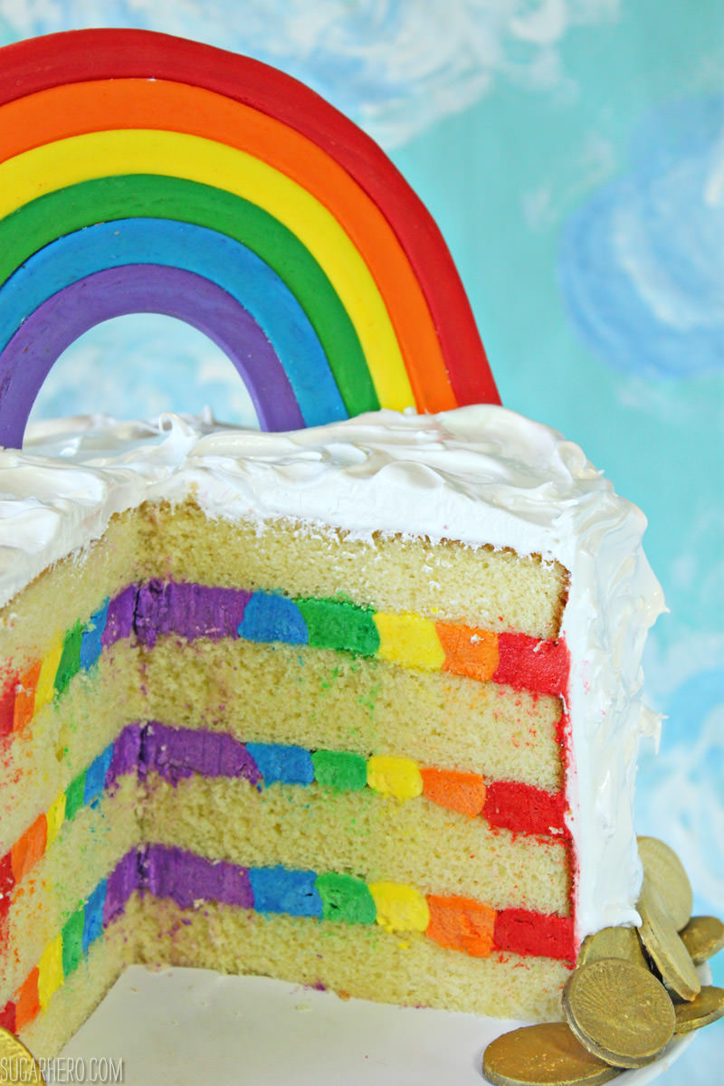 Rainbow in the Clouds Cake - with a rainbow on top AND a frosting rainbow hidden inside! | From SugarHero.com