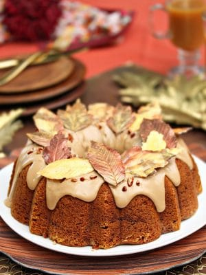 Pumpkin Pound Cake with a thick glaze and chocolate leaves on top.