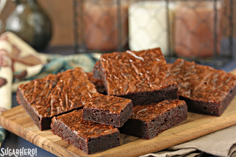 Ultimate Fudgy Chocolate Brownies - brownies stacked up on a plate | From SugarHero.com
