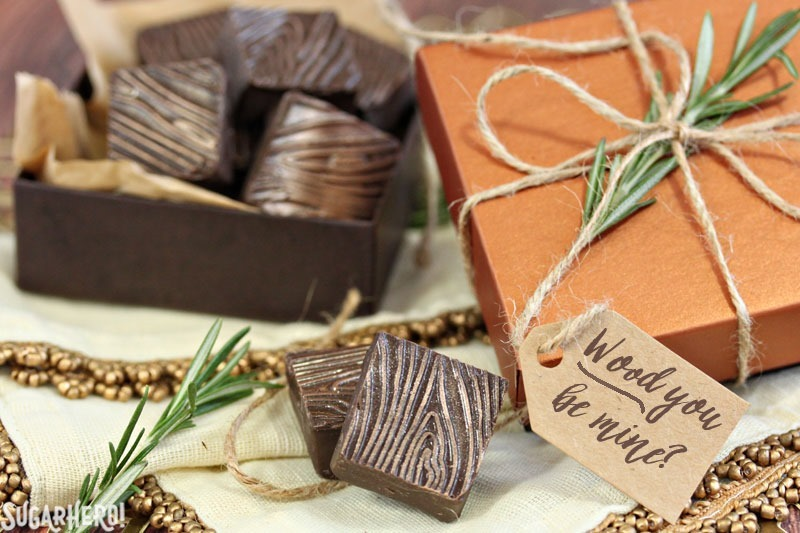 Rosemary Raspberry Truffles - chocolate truffles flavored with rosemary and raspberry. Learn how to get this elegant wood grain pattern on your chocolates! | From SugarHero.com