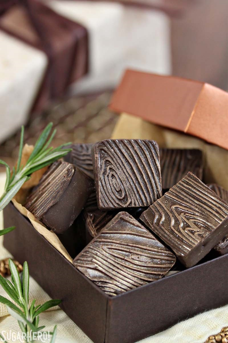 Rosemary Raspberry Truffles - box of square chocolate truffles with wood grain pattern | From SugarHero.com