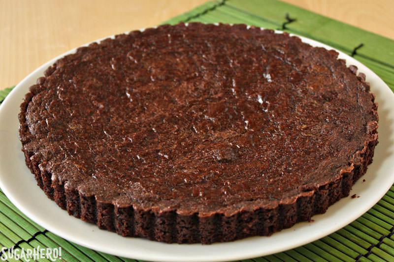 Pistachio Marzipan Brownie Tart | From SugarHero.com
