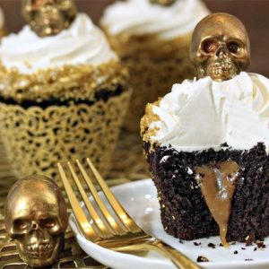 Caramel-Stuffed Chocolate Cupcakes with Caramel Skulls | From SugarHero.com
