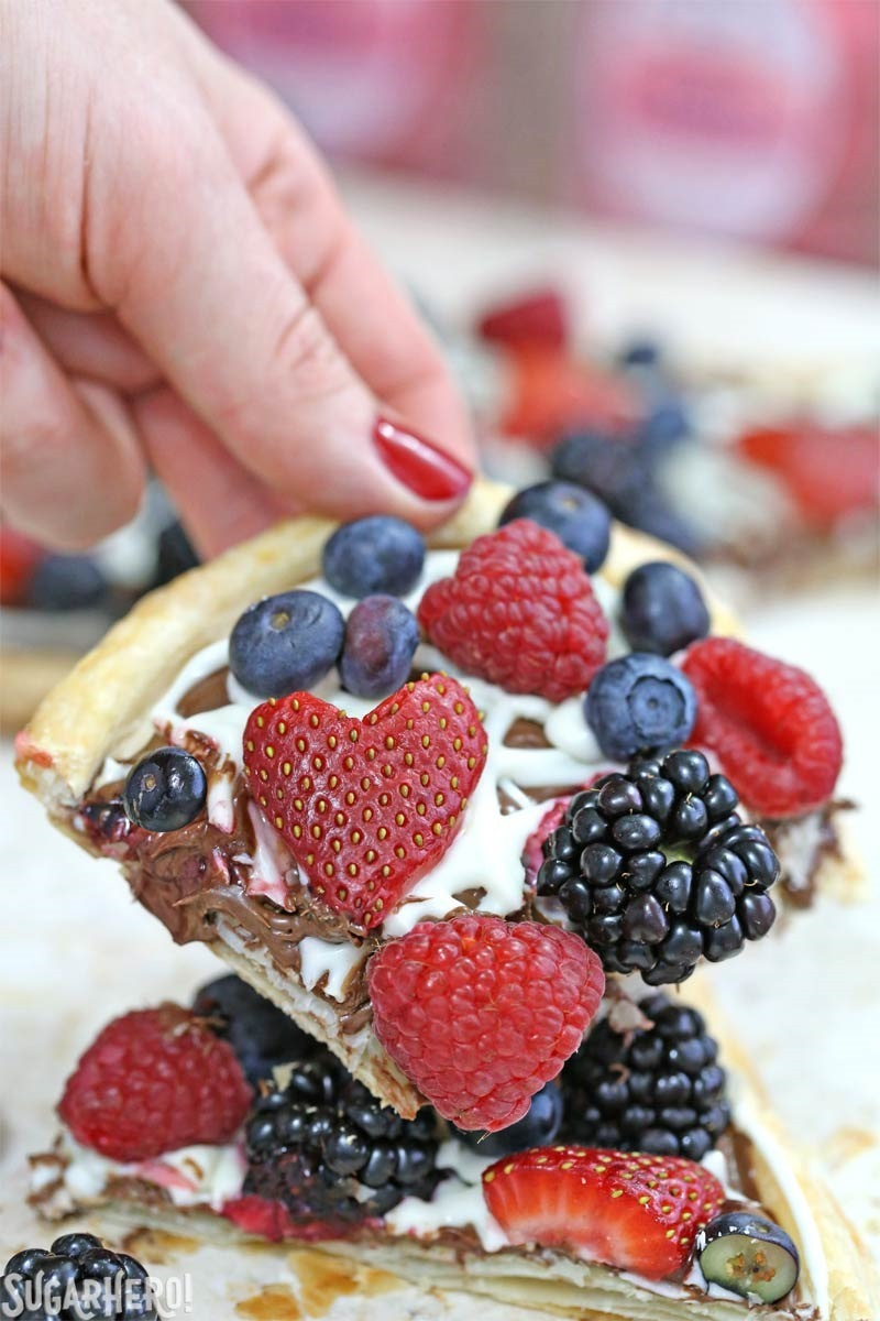 Nutella Puff Pastry Pizza is easy and gourmet. You'll love the combination of buttery puff pastry, Nutella, white chocolate, and juicy fresh berries!   From SugarHero.com