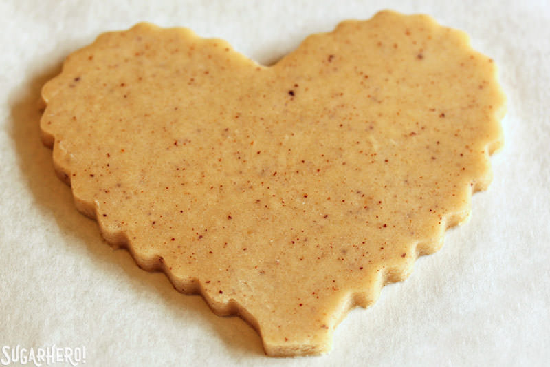 Brown Butter Heart Cookies - close-up on a cut-out cookie ready to be baked | From SugarHero.com