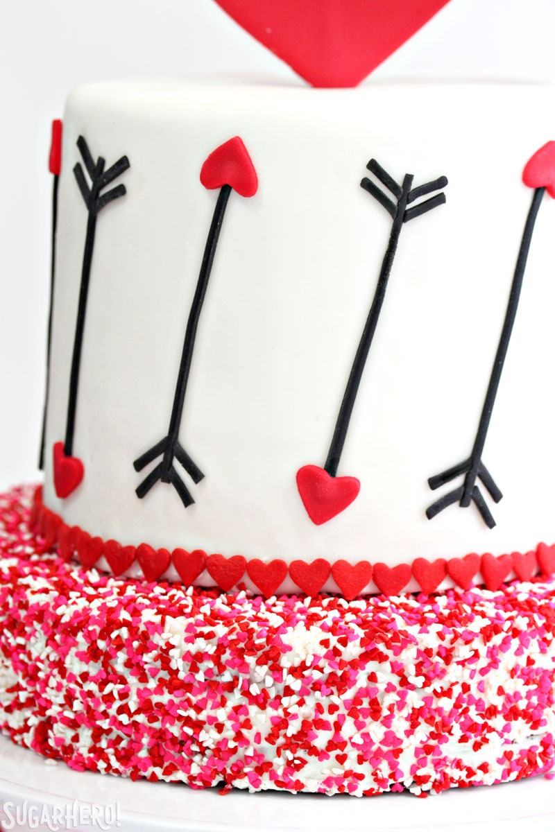 Pink and Red Velvet Valentine's Day Cake - a pink and red velvet cake with a heart and arrow design for Valentine's Day! | From SugarHero.com
