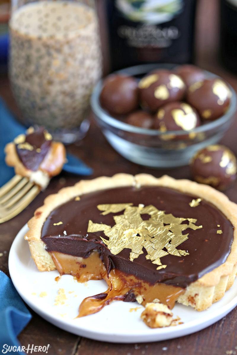Baileys Chocolate Caramel Tarts - mini tarts with Baileys salted caramel and Baileys chocolate ganache! | From SugarHero.com