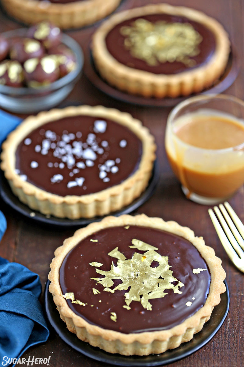 Baileys Chocolate Caramel Tarts - mini tarts with Baileys salted caramel and Baileys chocolate ganache! | From SugarHero.com