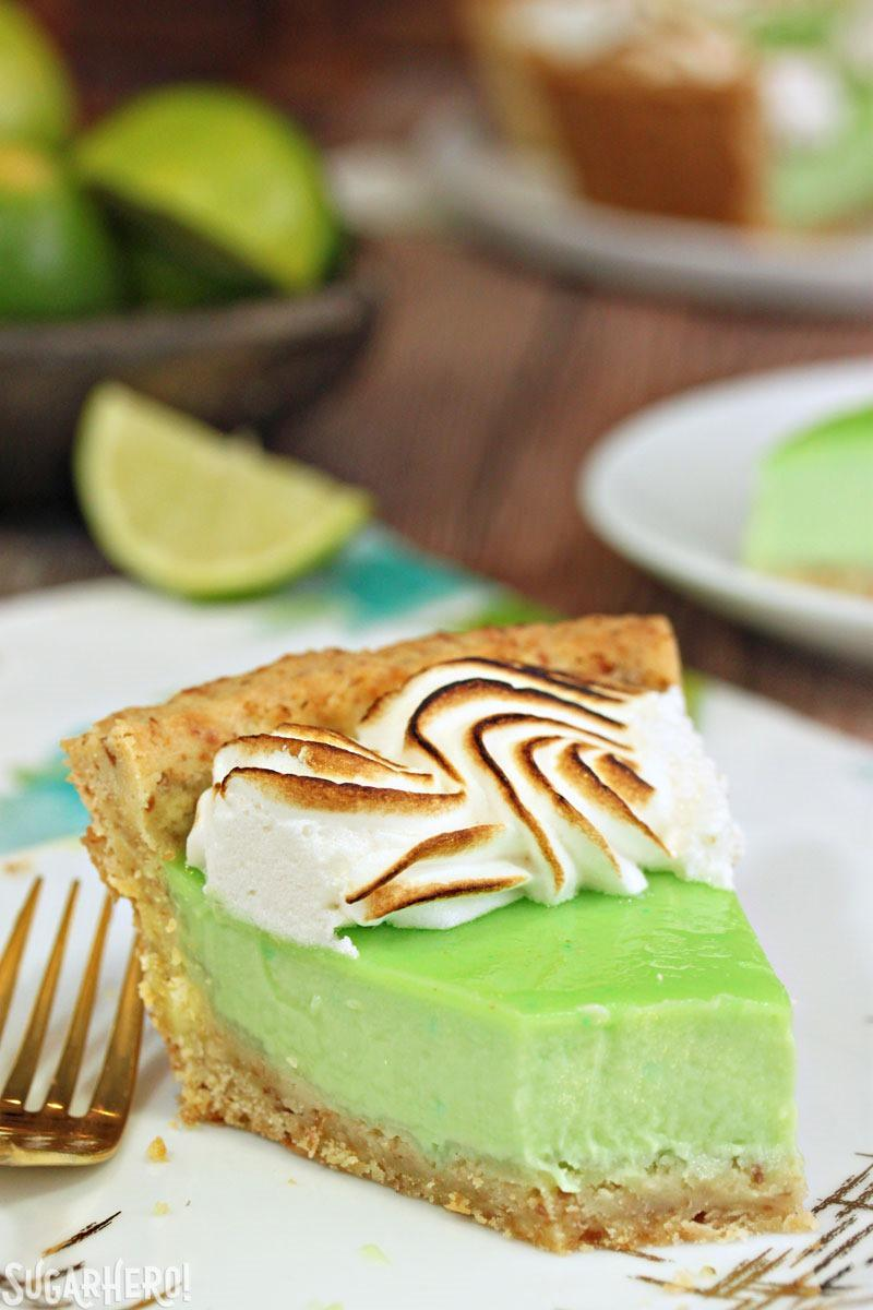 Toasted Coconut Lime Meringue Tart - with a tangy lime filling and toasted meringue on top!   From SugarHero.com