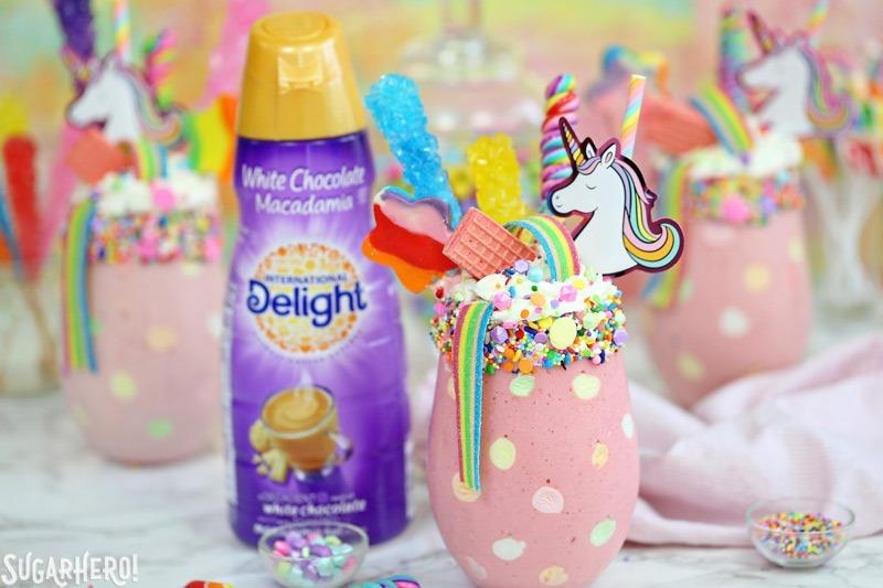 Unicorn Milkshakes - strawberry milkshakes topped with a magical assortment of rainbow candies and treats! | From SugarHero.com
