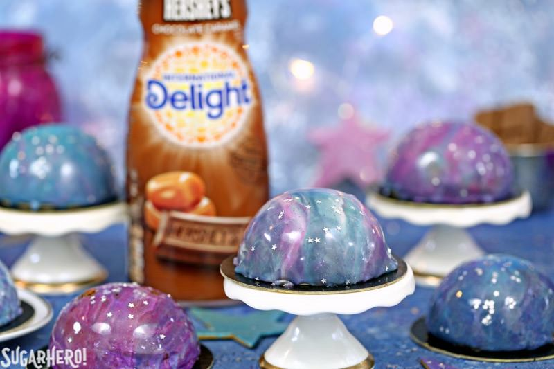 Galaxy Mousse Cakes - A close up shot of the mini cakes on mini cake stands. | From SugarHero.com