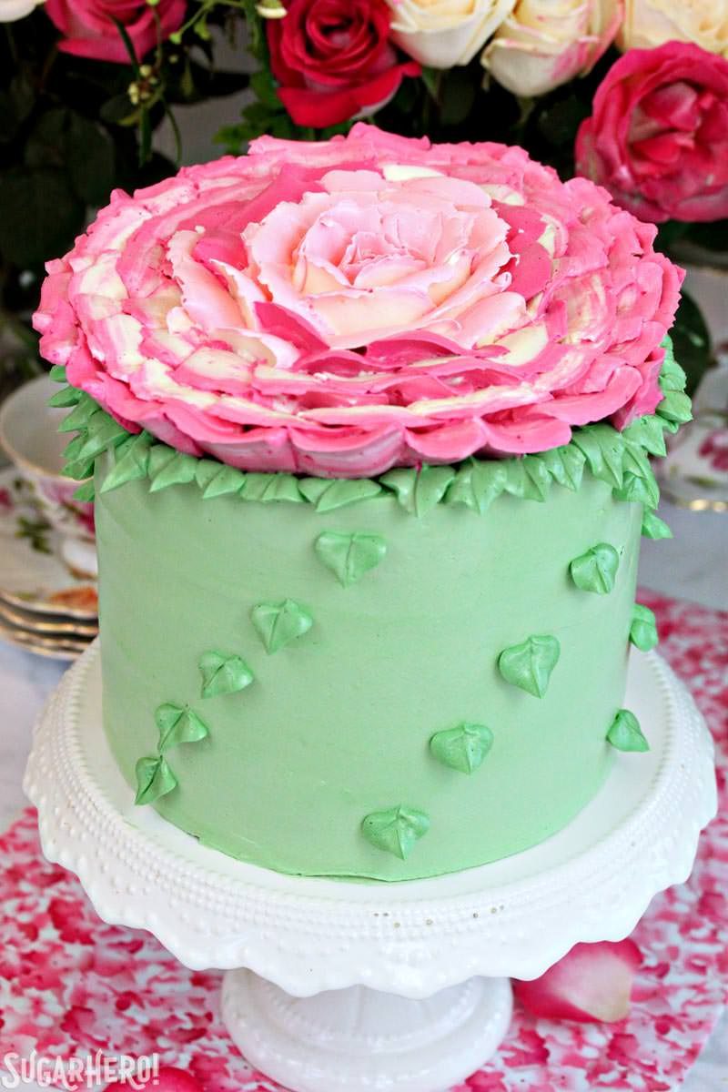 Giant Rose Cake - a gorgeous four-layer cake topped with a huge buttercream rose! | From SugarHero.com