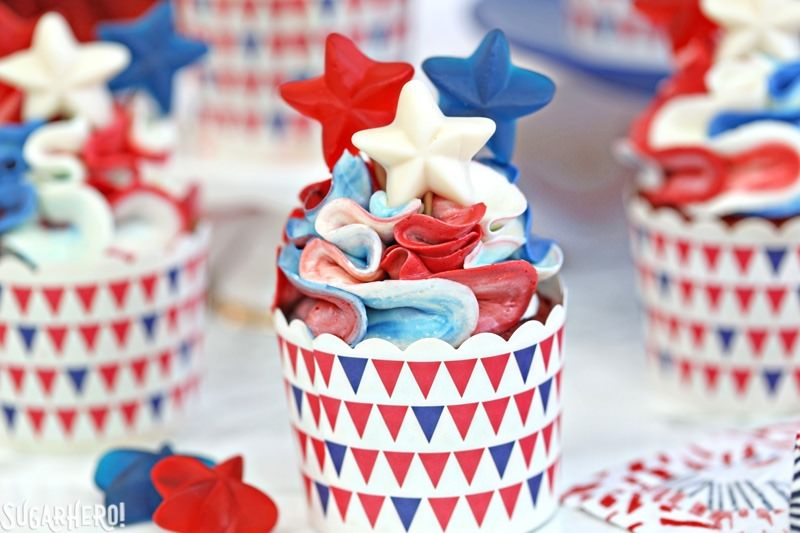 Red, White and Blue Cupcakes - pretty ruffled red velvet cupcakes, perfect for the Fourth of July! | From SugarHero.com