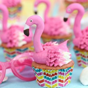Group of flamingo cupcakes on blue background