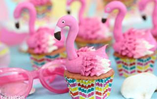 Flamingo Cupcakes - pink lemonade cupcakes decorated to look like pink flamingos! Perfect for summer! | From SugarHero.com