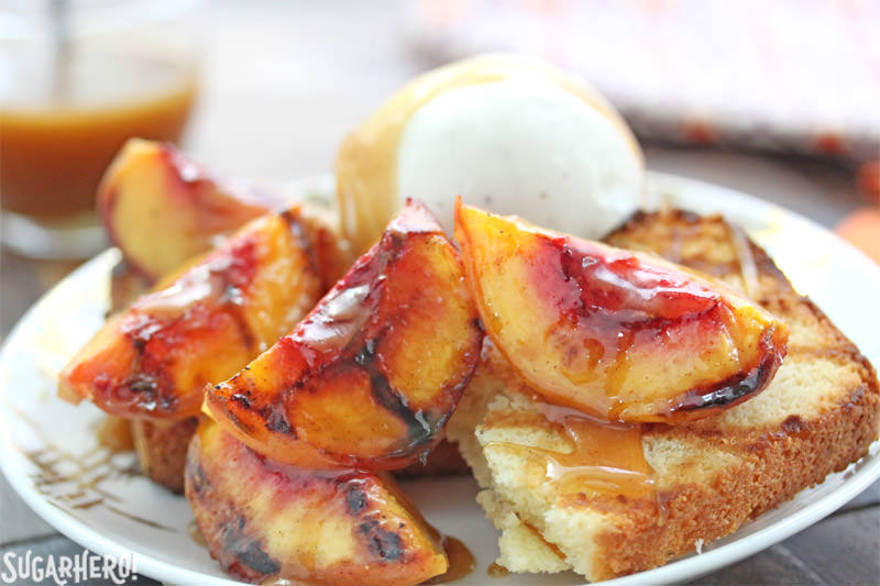 Grilled pound cake with grilled peaches, vanilla ice cream, and honey caramel sauce | From SugarHero.com