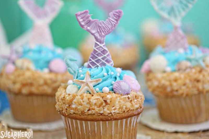 Mermaid Cupcakes - close-up of mermaid cupcake with purple chocolate mermaid tail | From SugarHero.com