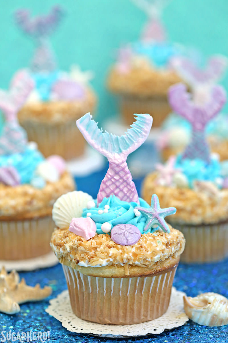 Mermaid Cupcakes - gorgeous under-the-sea cupcakes with edible mermaid tails and chocolate seashells! | From SugarHero.com