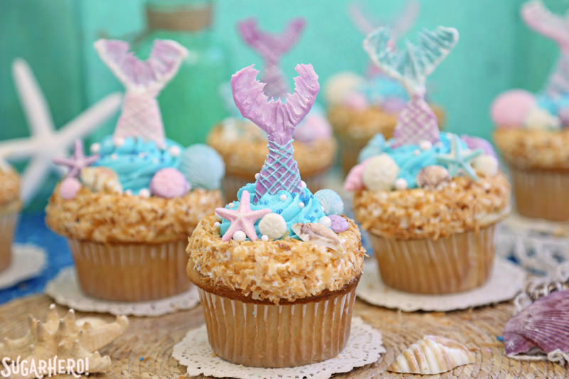 Mermaid Cupcakes - a grouping of gorgeous mermaid cupcakes, with chocolate mermaid tails | From SugarHero.com