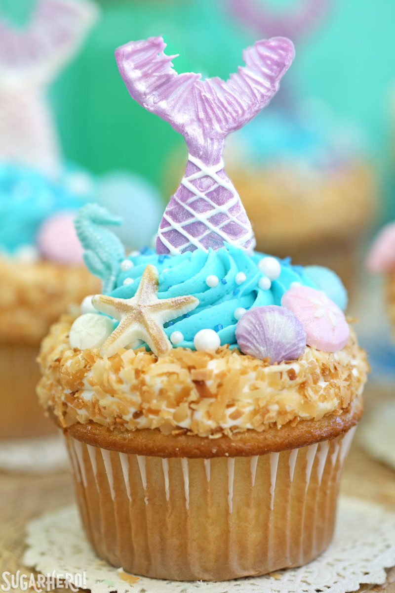 Mermaid Cupcakes - close up of a single mermaid cupcake with a purple mermaid tail | From SugarHero.com