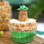 Pineapple Cupcakes with Coconut Frosting | From SugarHero.com