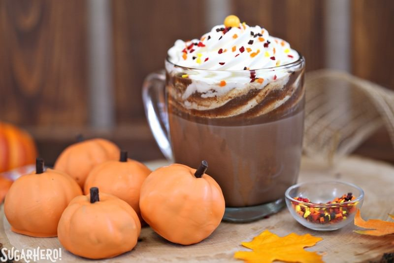Pumpkin Spice Hot Chocolate Truffles - mug of pumpkin spice hot chocolate with pumpkin truffles next to it   From SugarHero.com