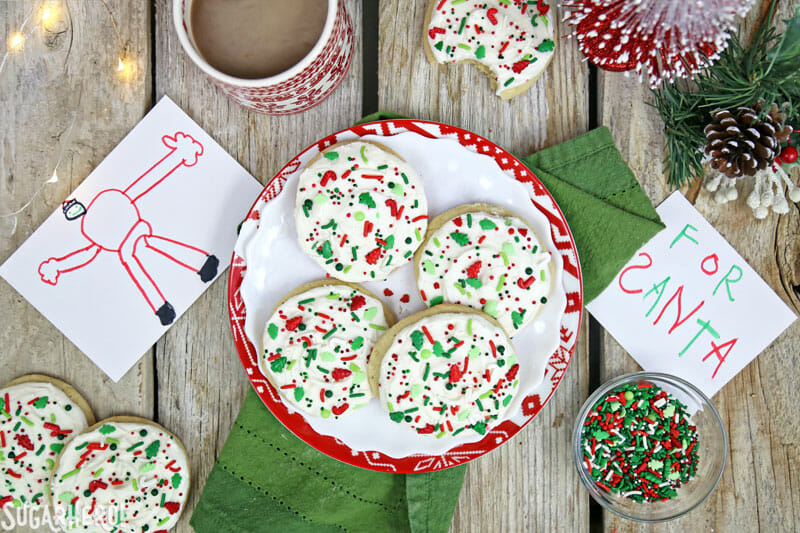 Big Soft Sugar Cookies - sugar cookies on a plate, with notes for Santa scattered around | From SugarHero.com