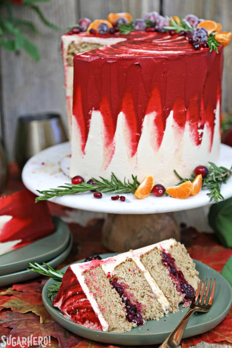 Brown Sugar Cranberry Cake - brown sugar cranberry cake with a single slice displayed in front of it | From SugarHero.com