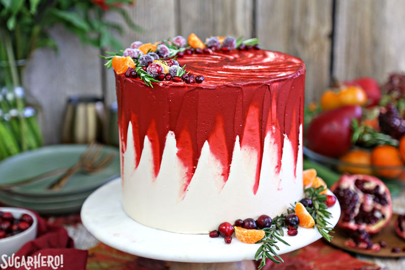 Brown Sugar Cranberry Cake - on marble cake stand decorated with fresh fruit and rosemary | From SugarHero.com