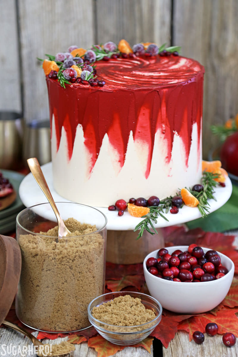 Brown Sugar Cranberry Cake - cake with brown sugar and a bowl of cranberries in front | From SugarHero.com