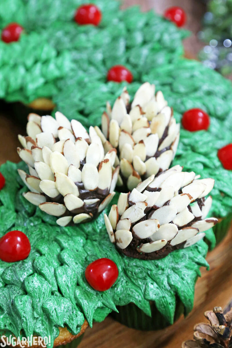 Pull-Apart Cupcake Wreath Cake - close-up of the edible pine cones on top. | From SugarHero.com