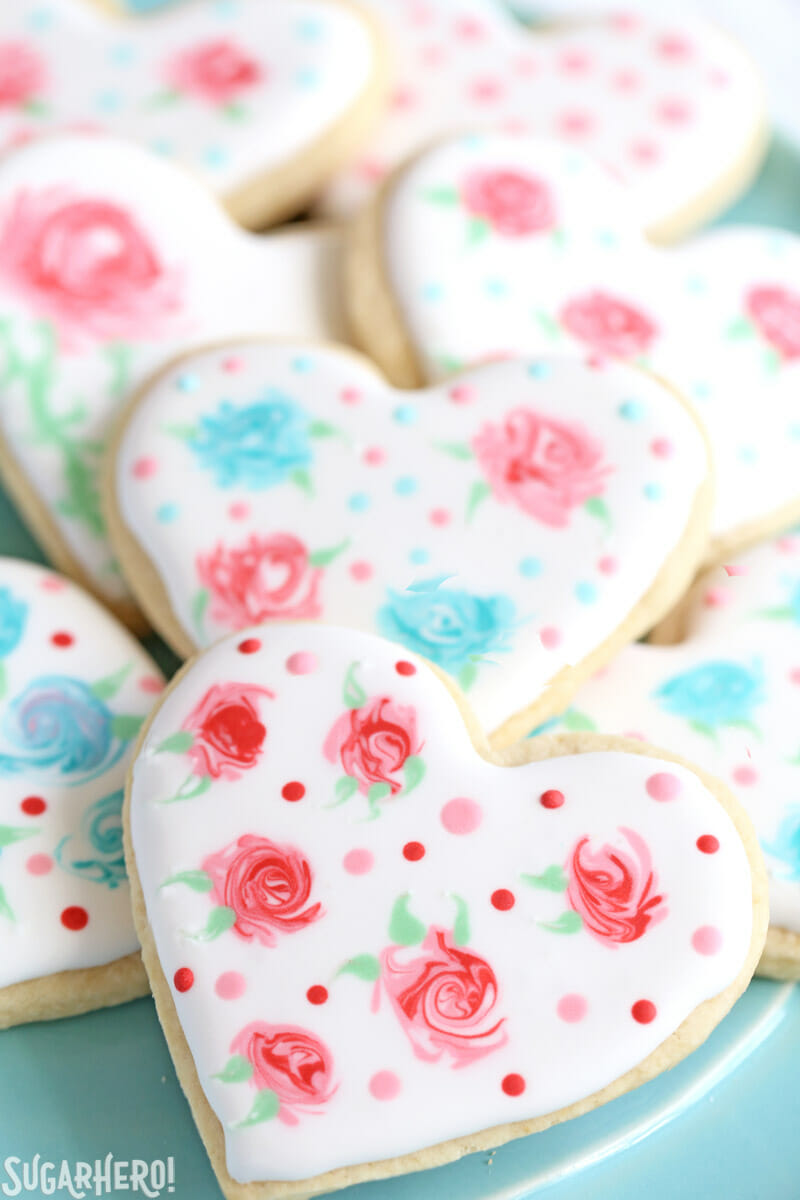 Valentine's Day Sugar Cookies - sugar cookies with an elegant rose design made out of royal icing | From SugarHero.com