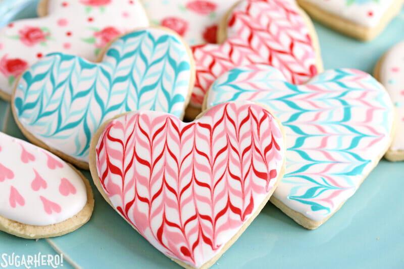 Valentine's Day Sugar Cookies - sugar cookies with a royal icing zig-zag pattern for Valentine's Day | From SugarHero.com