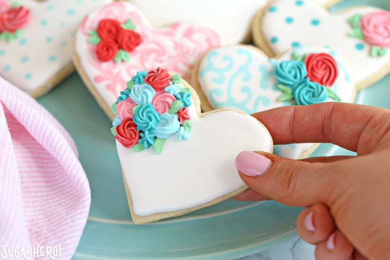 Valentines Day Sugar Cookies Close Up Of Hand Holding A Sugar Cookie Decorated With