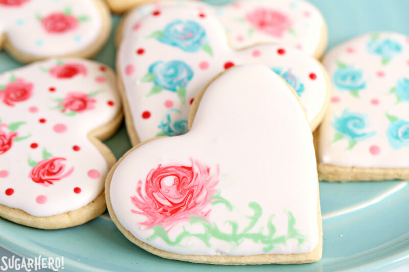 Valentine's Day Sugar Cookies - sugar cookies with an elegant rose design made from royal icing | From SugarHero.com