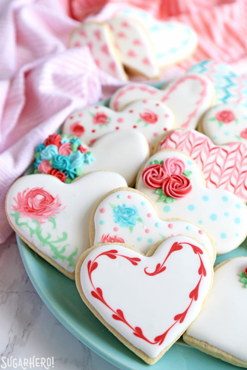 Valentine's Day Sugar Cookies - a platter of assorted sugar cookies decorated for Valentine's Day | From SugarHero.com