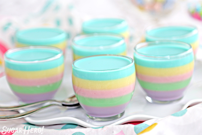 Pastel Rainbow Gelatin Cups – group of gelatin cups without whipped cream on top | From SugarHero.com