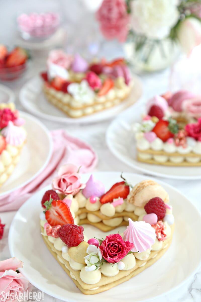 Trendy Cream Tarts - heart-shaped cream biscuits with flowers, berries, and candy on top | From SugarHero.com