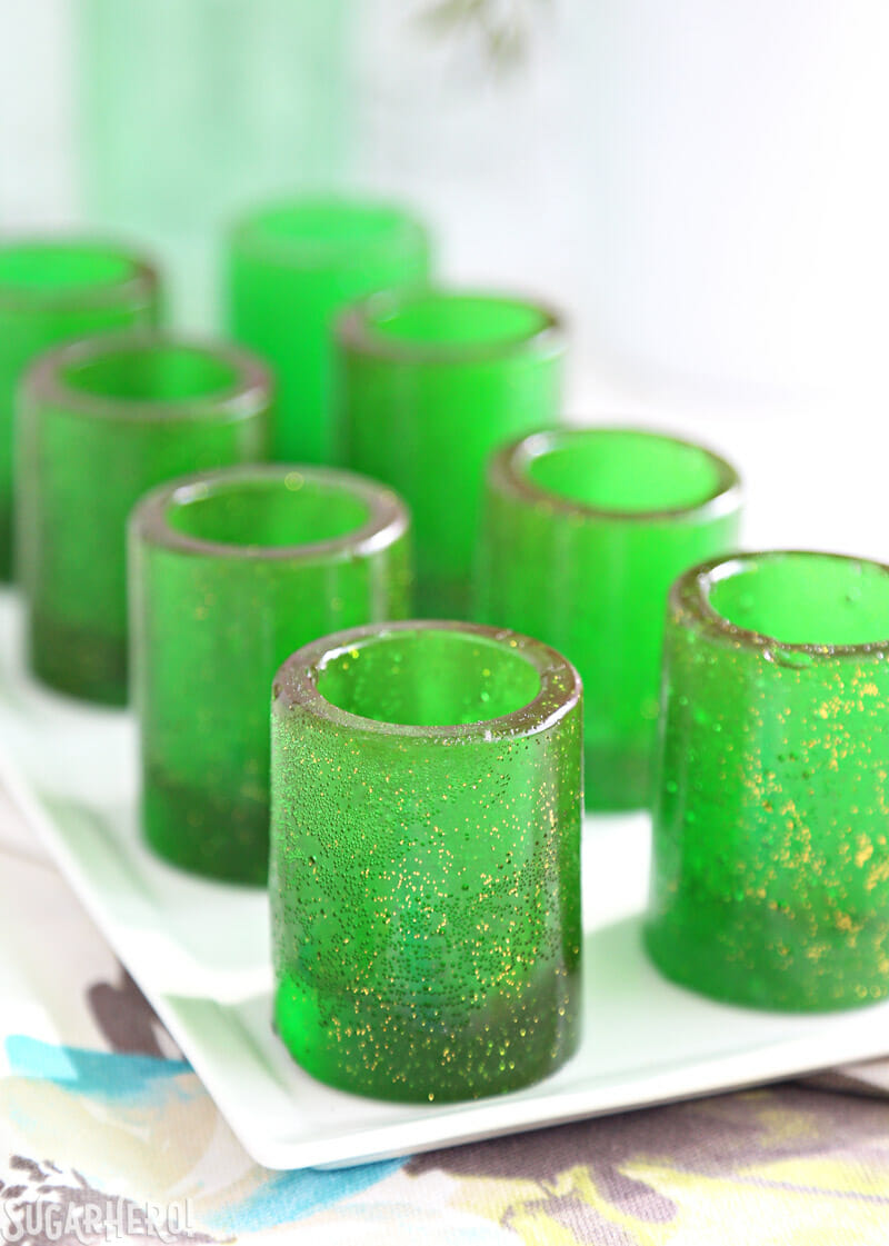 DIY Candy Shot Glasses - group of candy glasses lined up on a table | From SugarHero.com