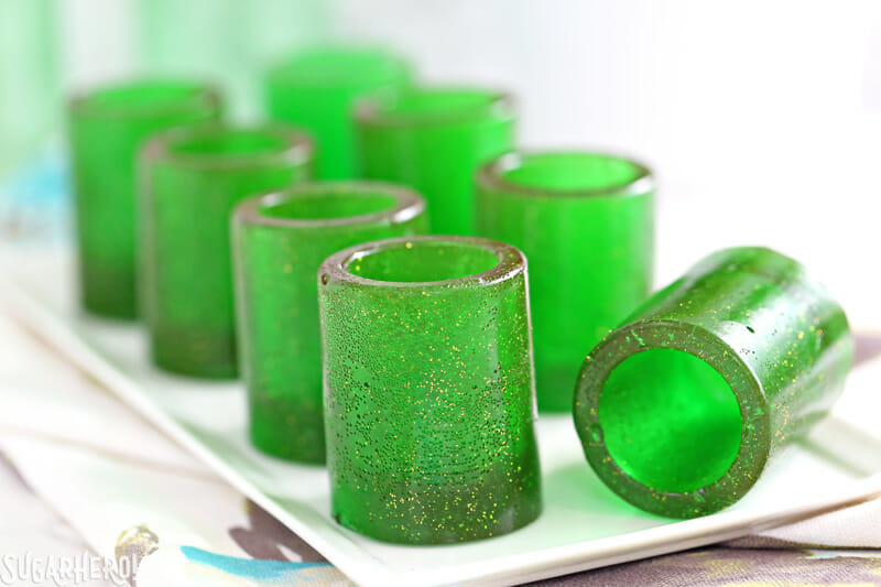 DIY Candy Shot Glasses - group of candy shot glasses with one glass lying on its side | From SugarHero.com