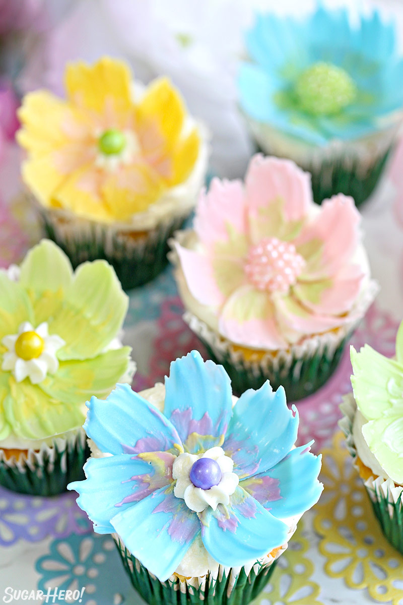 Easy chocolate flower cupcakes sugarhero easy chocolate flower cupcakes a group of lemon coconut cupcakes with edible chocolate flowers izmirmasajfo