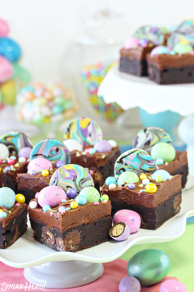 Malted Milk Chocolate Brownies - brownies on a cake stand   From SugarHero.com