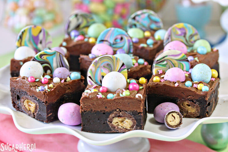 Malted Milk Chocolate Brownies - group of colorful brownies on a cake stand   From SugarHero.com
