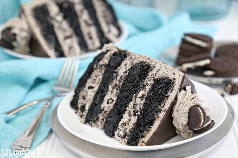Cookies and Cream Cake - two slices of cookies and cream cake on white plates | From SugarHero.com