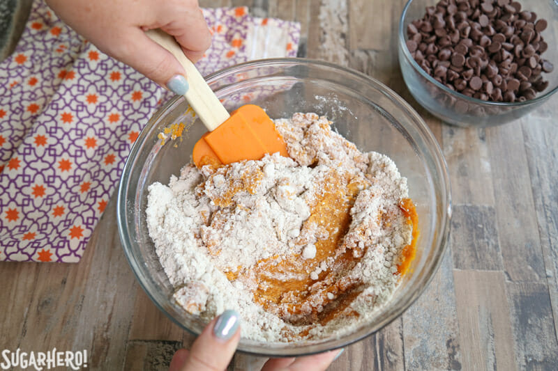 3-Ingredient Pumpkin Chocolate Chip Cookies - stirring together the cake mix and pumpkin puree | From SugarHero.com